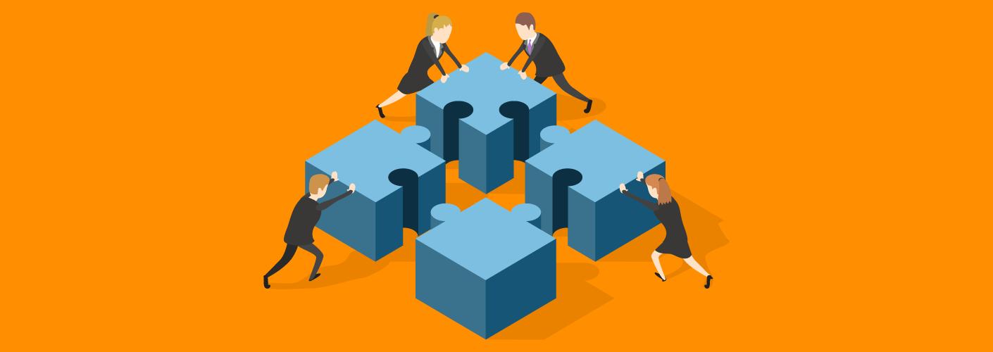 pessoas trabalhando juntas para unir peças do quebra-cabeça que representa como liderar uma equipe em eventos